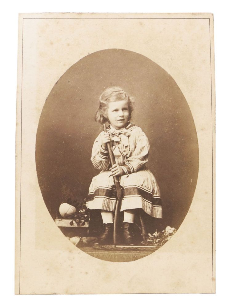 CABINET CARD PHOTOGRPAH Of A SEATED YOUNG GIRL HOLDING A RIFLE. Robert - Photograher Faulkner, 1823 - 1890.