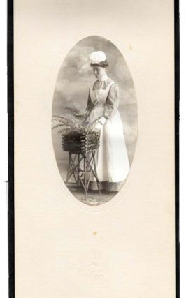 PHOTOGRAPH Of A NURSE, STANDING By A PLANTER. Nursing History.